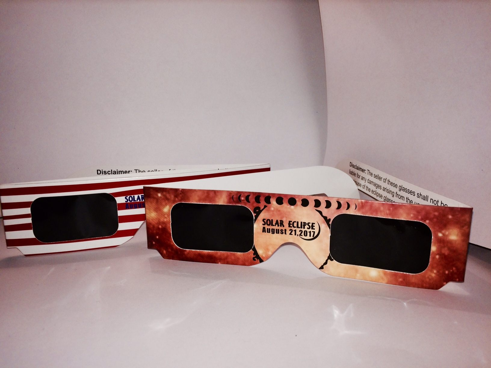 Eclipse glasses should not let any other light through except for an orange glow from the sun